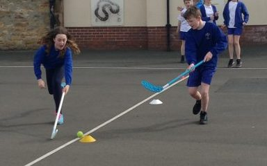 Year 6 develop their hockey skills…